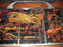 220px-IBM402plugboard.Shrigley.wireside.jpg