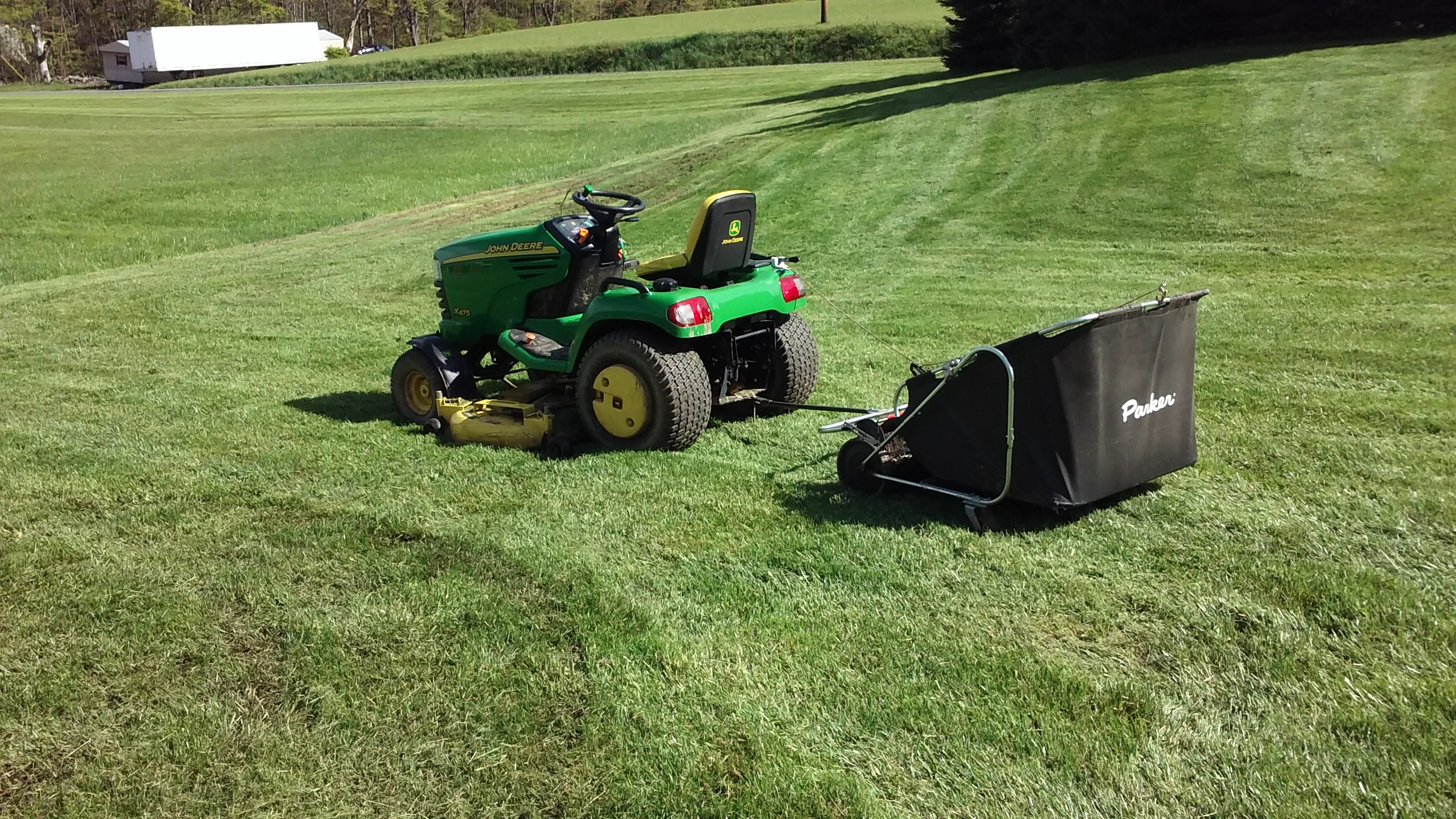 Click image for larger version.  Name:sweeping grass with the X475 and parker sweeper20170509_162104.jpg Views:28 Size:2.06 MB ID:364138