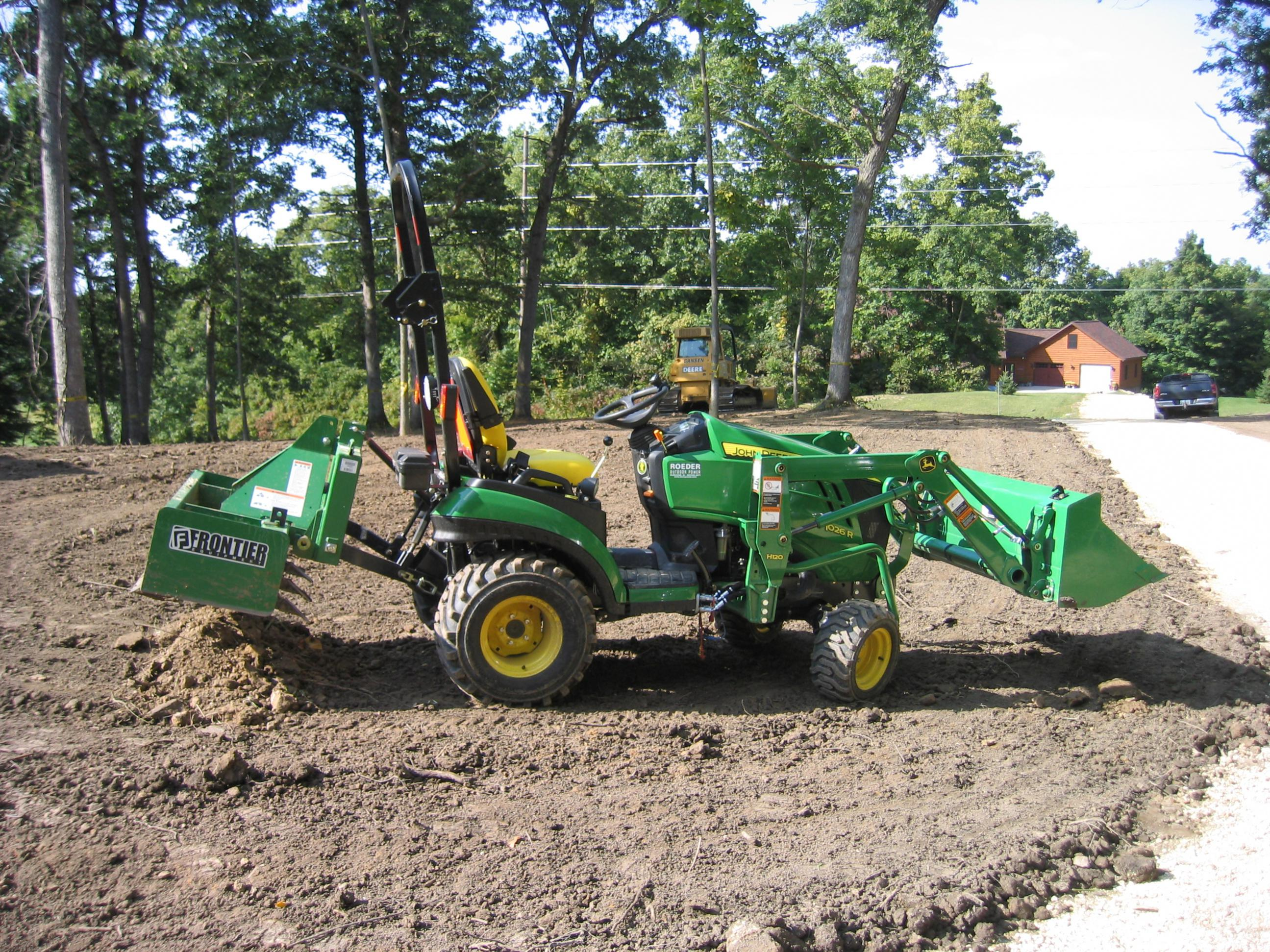 tractor in prefinish yard.jpg