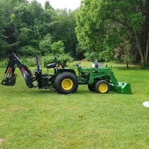 JD750 w/ Woodmaxx 7600 backhoe